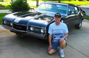 Bob Germoetta pictured with his Olds 442